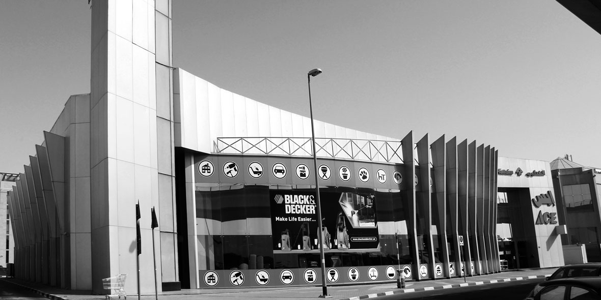 Black & White Photo Shot of a building - Black & Decker as well as Ace