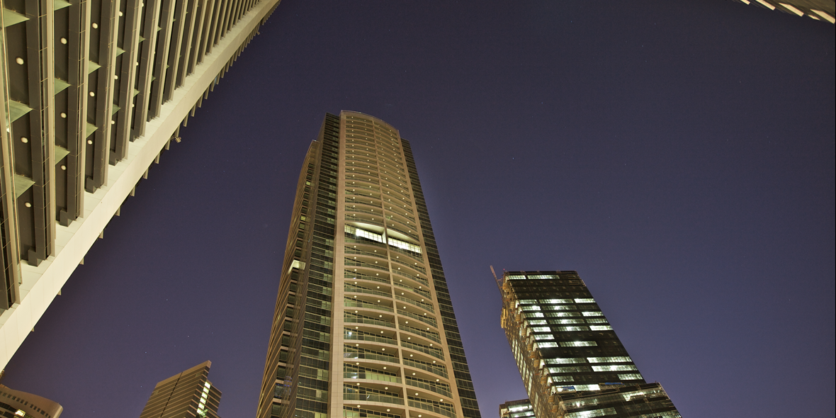 Nightime photo of tall buildings