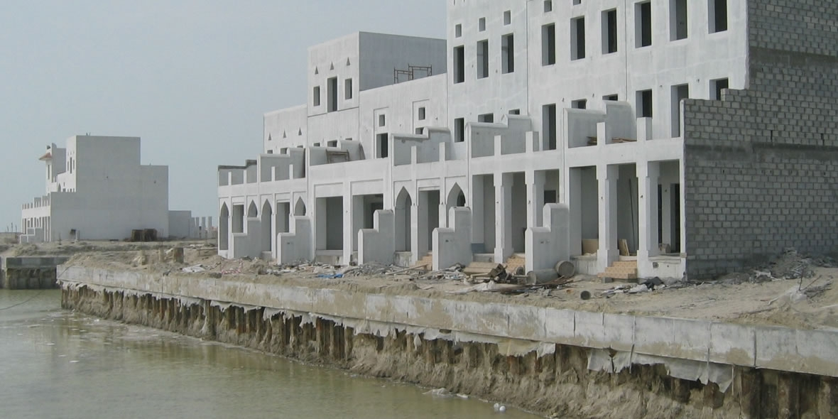 Newly Buillt Buildings With A Dity River